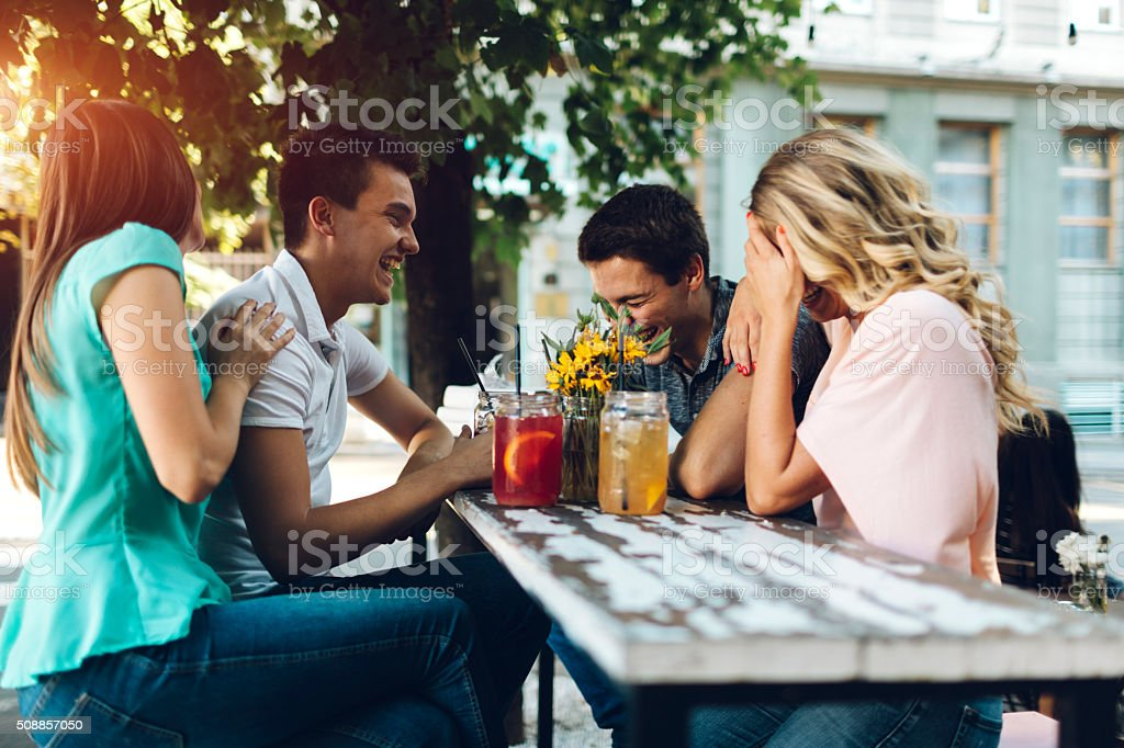Group of friends in cafe stock photo