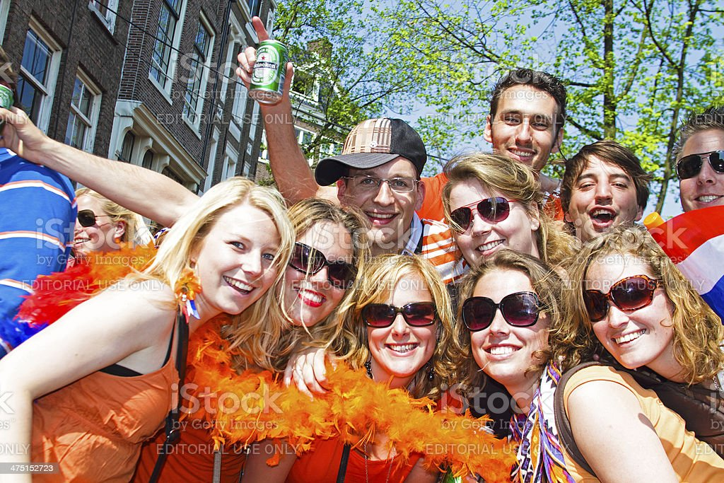 Group of friends in orange partying at queensday Netherlands stock photo