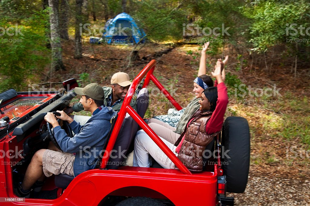 Group of friends in red jeep royalty-free stock photo