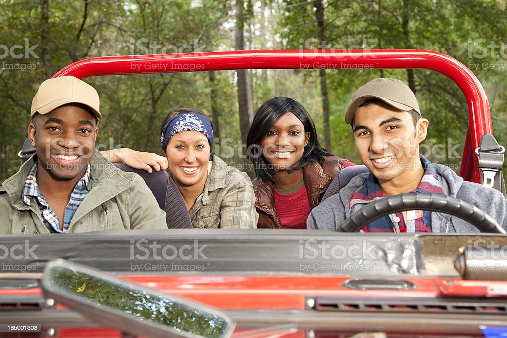 Group of friends in red jeep. royalty-free stock photo