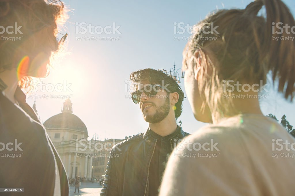 Group of friends in Rome, talking stock photo