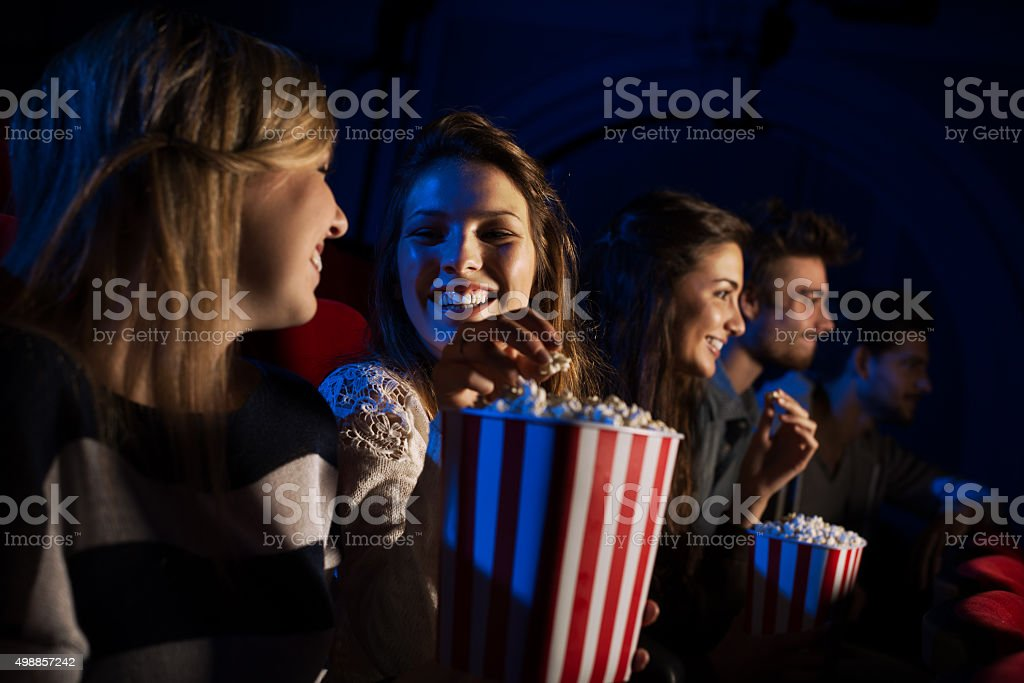 Group of friends in the movie theater stock photo