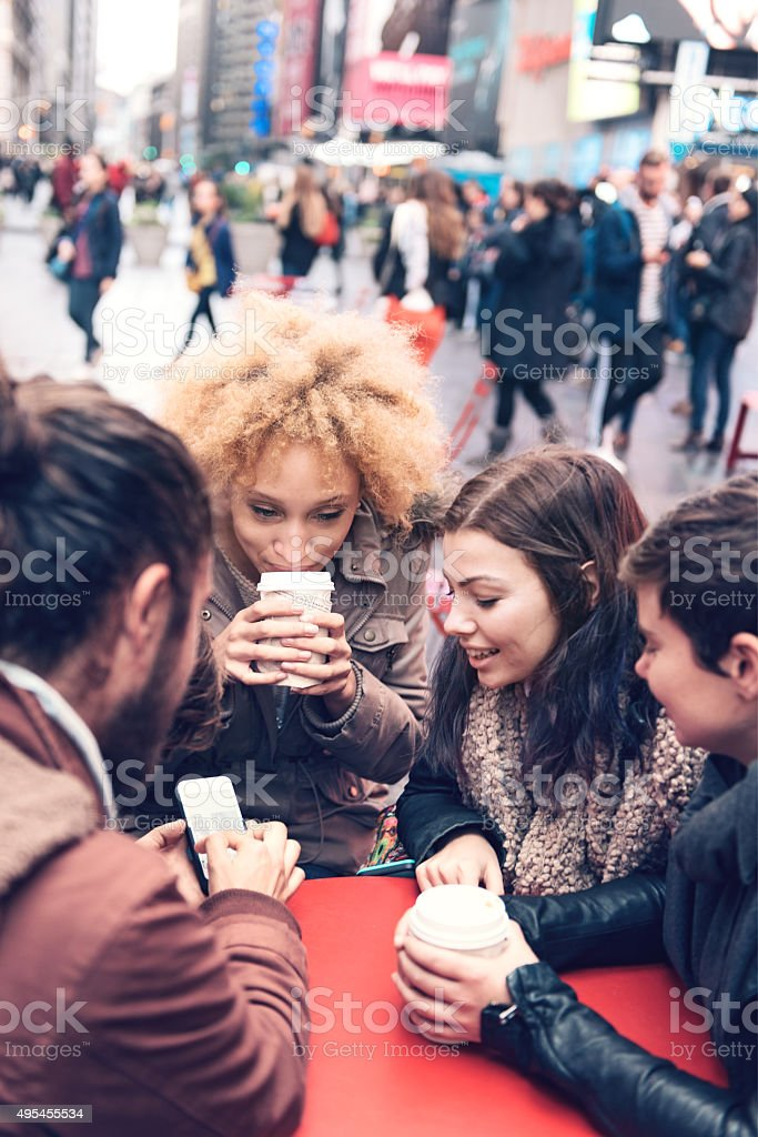 Group of friends in Time Square stock photo