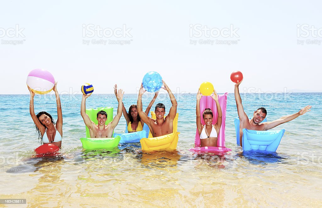 Group of friends is enjoying in the water. royalty-free stock photo