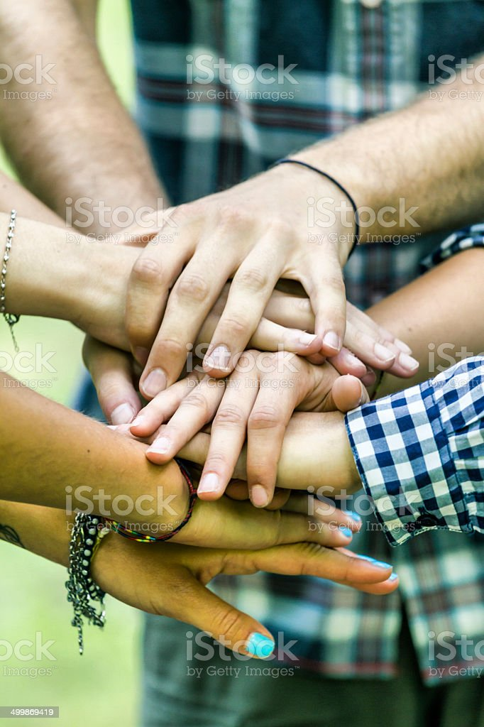 Group of friends joining hands royalty-free stock photo