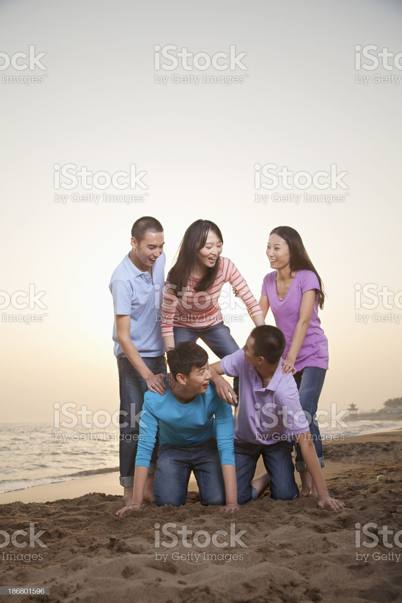 Group of Friends Making Human Pyramid on the Beach royalty-free stock photo
