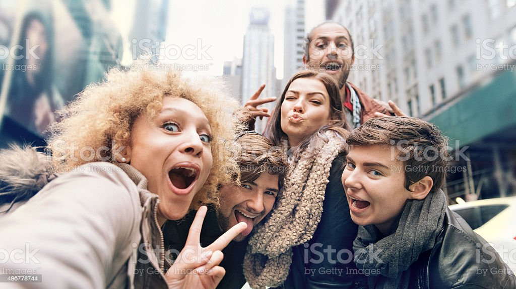 Group of friends making selfies stock photo