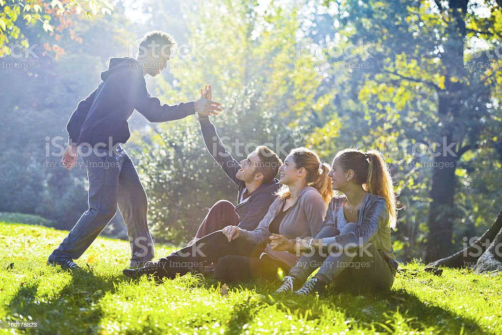 Group of Friends meeting in the park stock photo