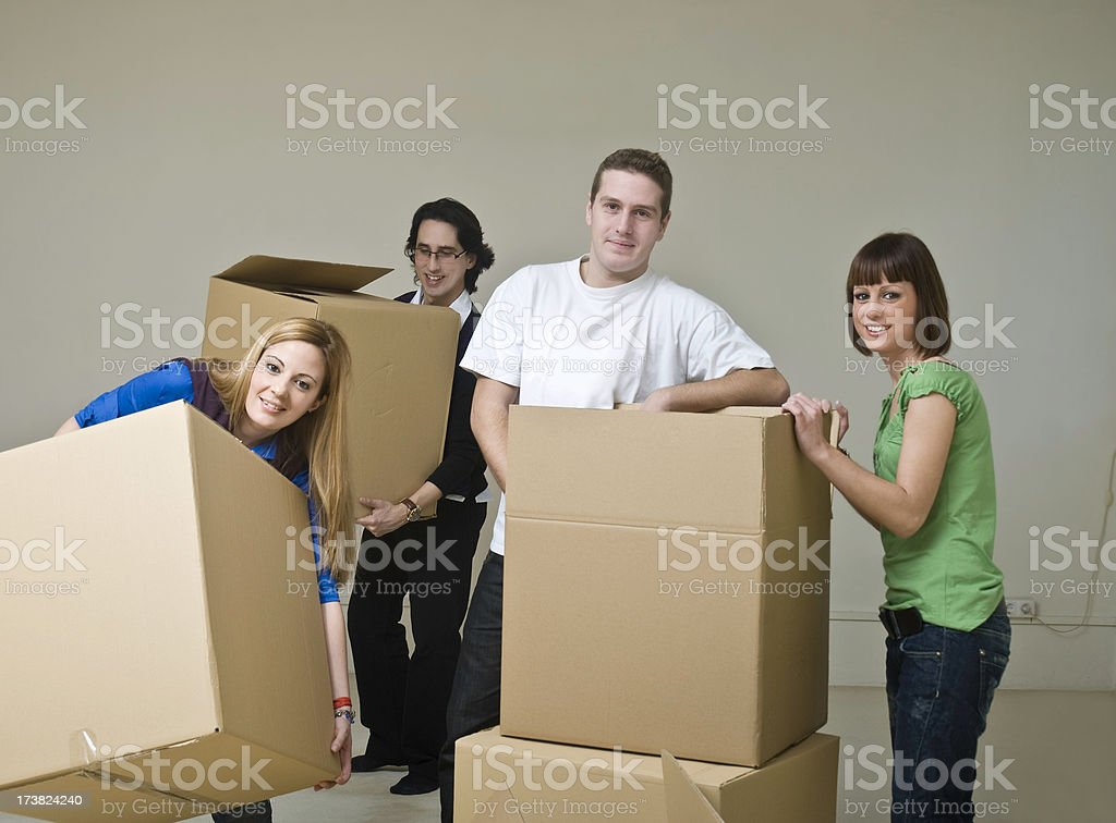 Group of friends moving to a new home royalty-free stock photo