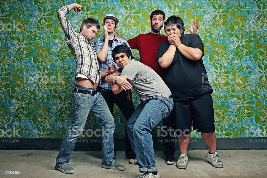 Group of Friends on Retro Wall royalty-free stock photo