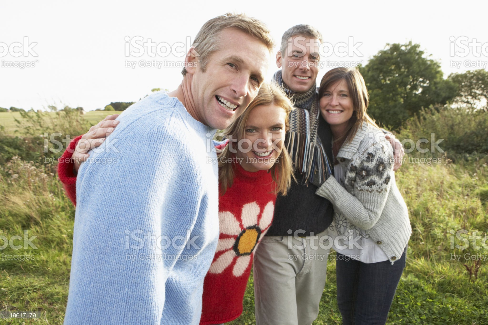 Group Of Friends On Walk In Autumn Countryside Together royalty-free stock photo