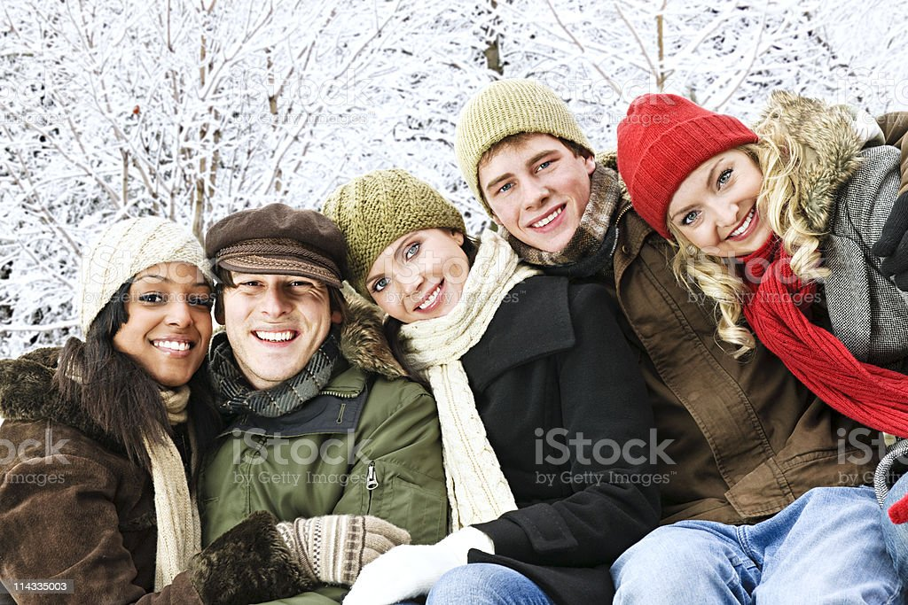 Group of friends outside in winter royalty-free stock photo