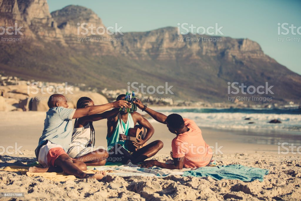 Group of friends partying on beach vacation stock photo