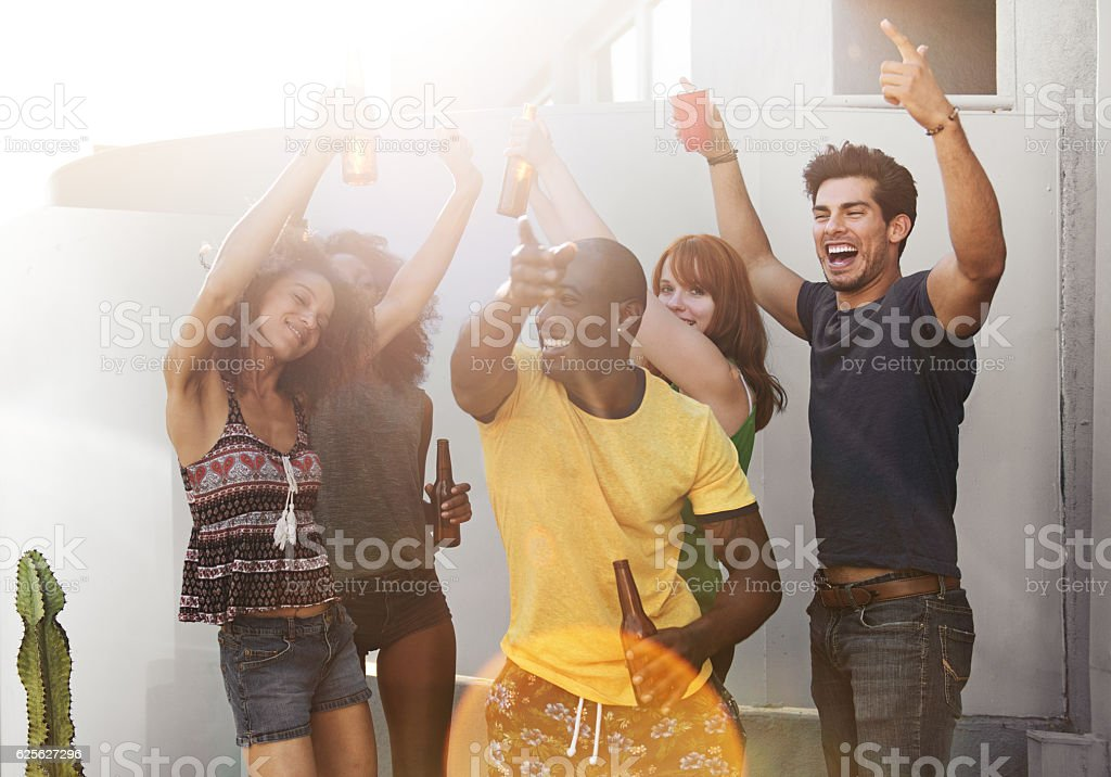 Group of friends partying on rooftop stock photo