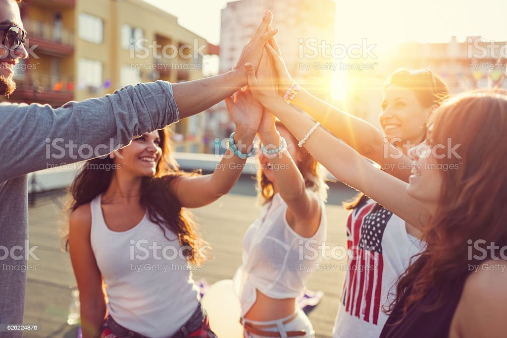 Group of friends partying on the rooftop stock photo