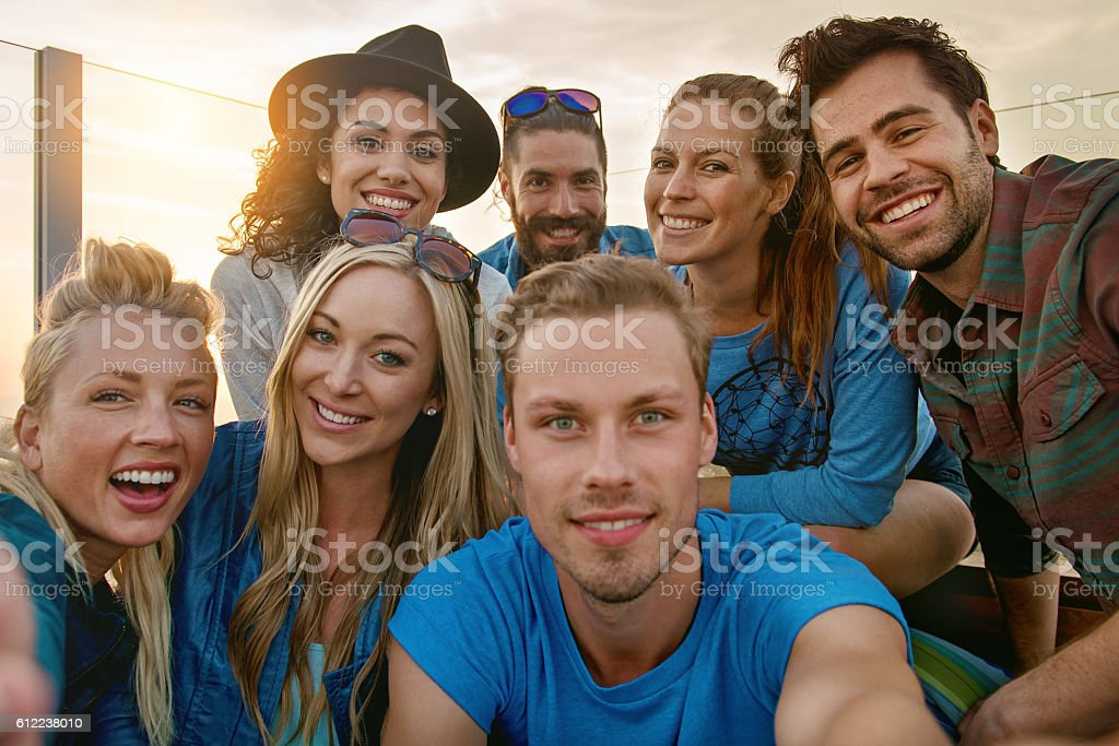 Group of friends partying, taking selfie stock photo