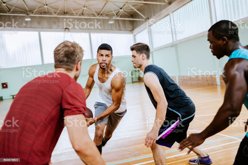 Group of friends playing basketball stock photo