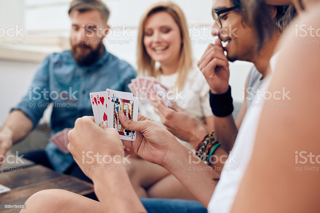 Group of friends playing card stock photo