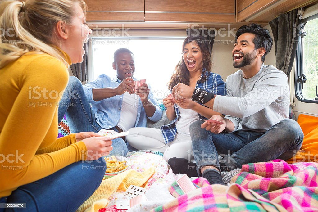 Group of Friends Playing Cards in Caravan stock photo
