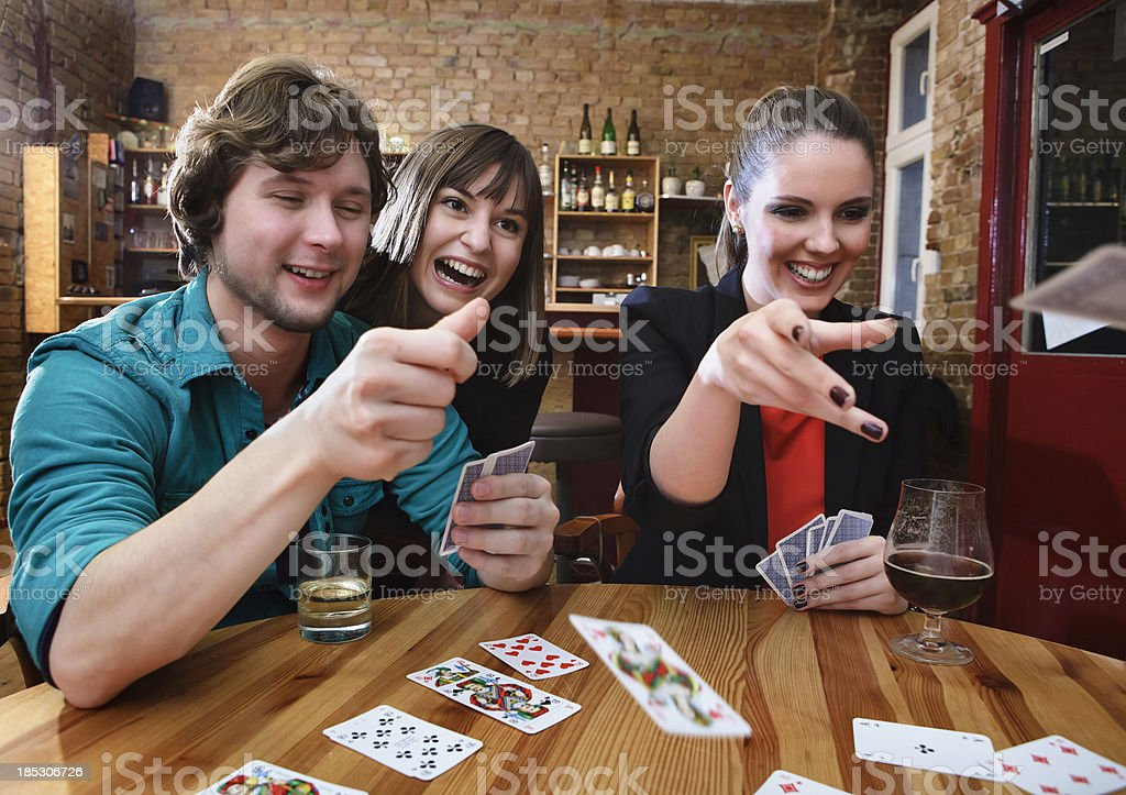 Group of Friends Playing Cards royalty-free stock photo