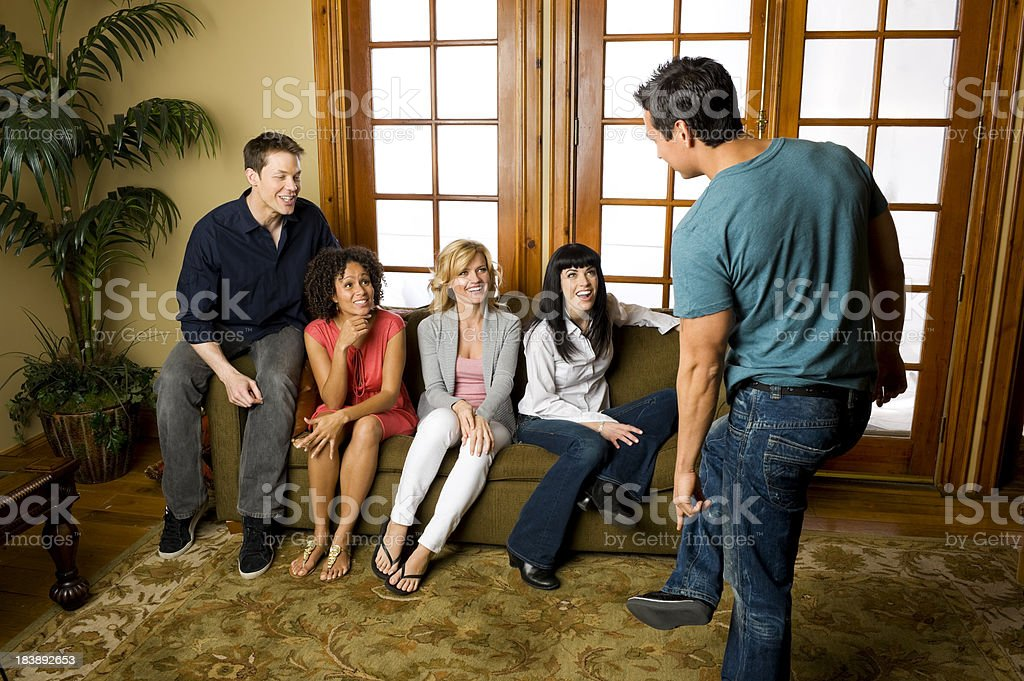 Group of Friends playing charades stock photo