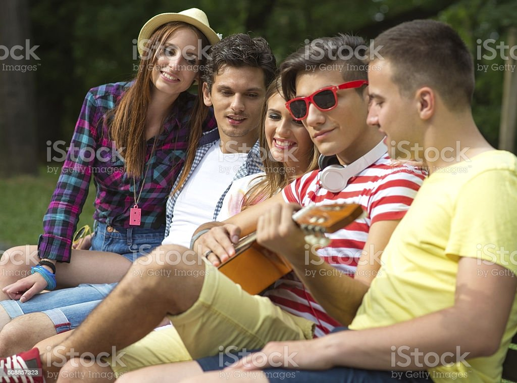 Group of  friends playing music royalty-free stock photo