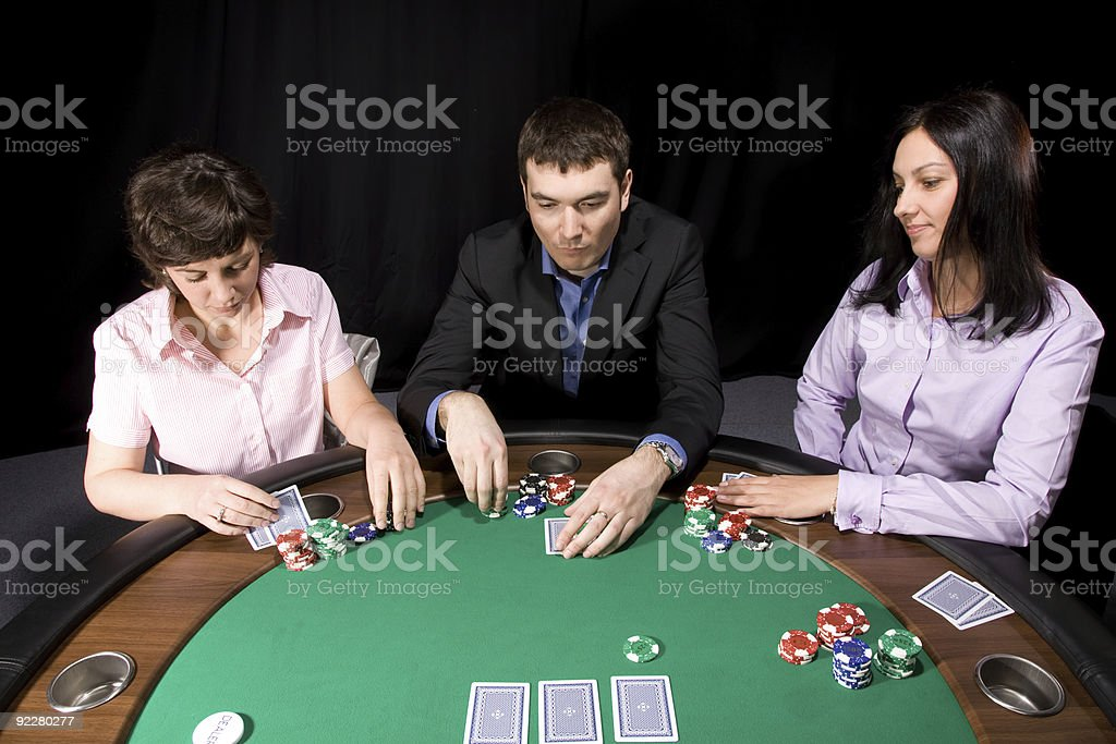 Group of friends playing poker royalty-free stock photo