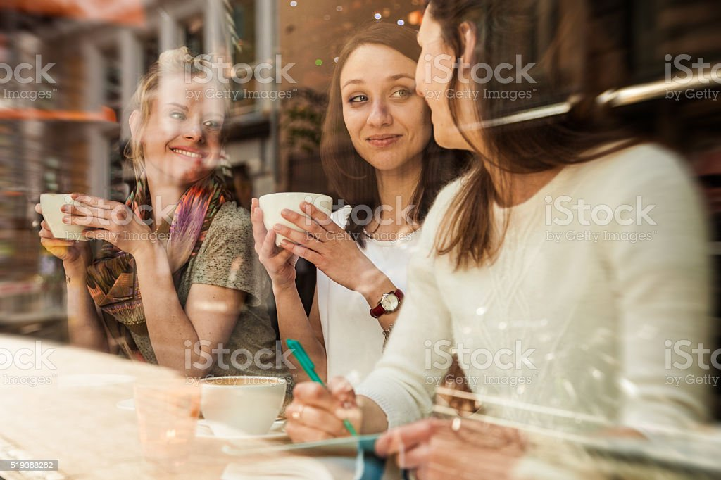 Group of friends relaxing at cafe in Scandinavia stock photo