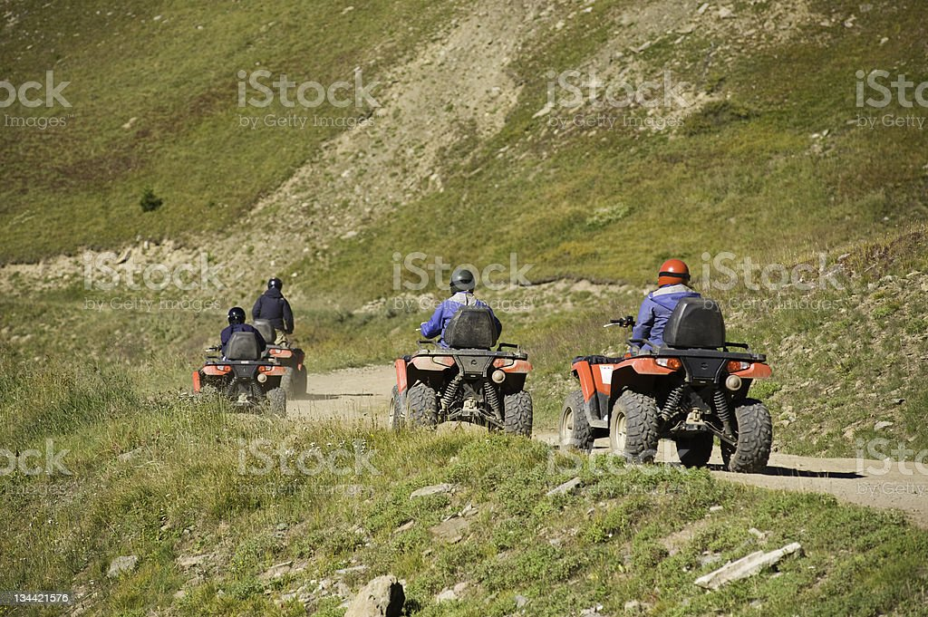 Group of Friends Riding ATV Vehicles royalty-free stock photo
