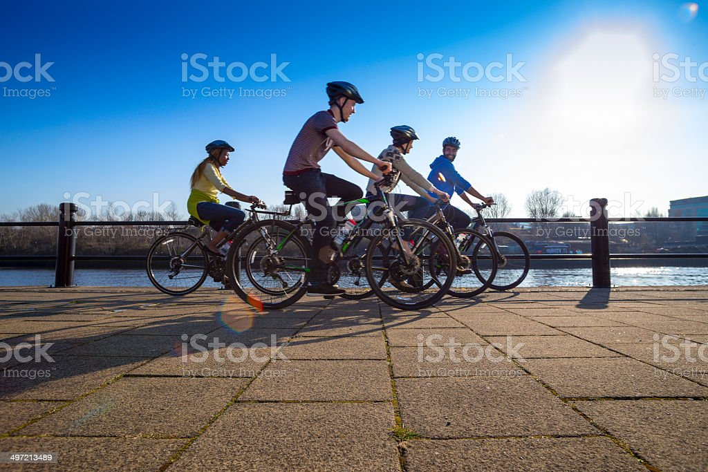 Group of Friends Riding Bikes stock photo