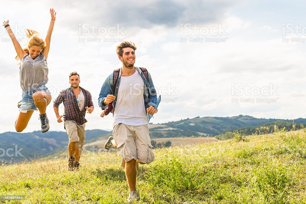 Group of friends running free stock photo
