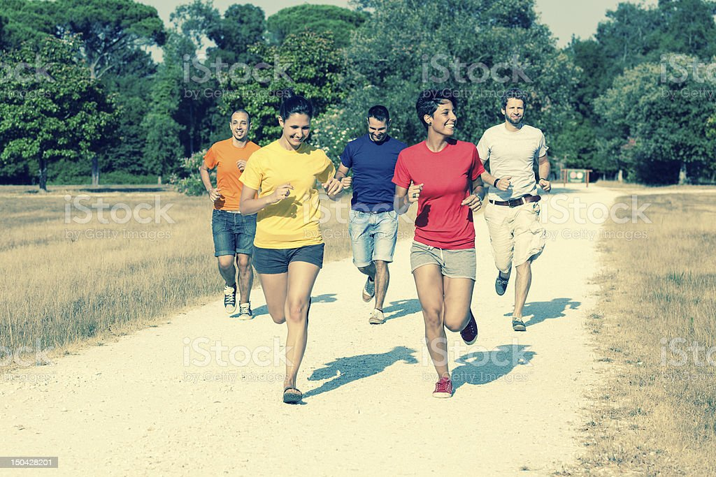 Group of Friends Running Outside royalty-free stock photo