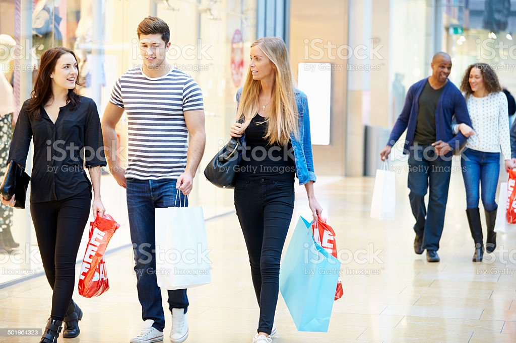 Group Of Friends Shopping In Mall Together stock photo