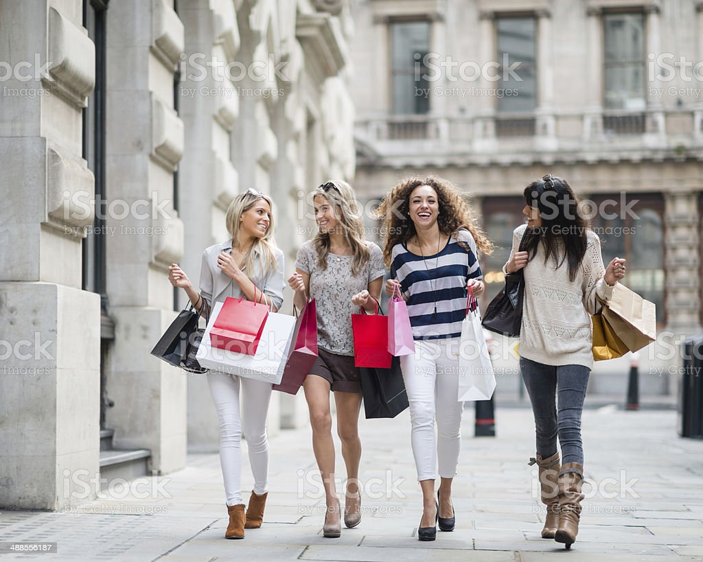 Group of friends shopping in the Mall stock photo