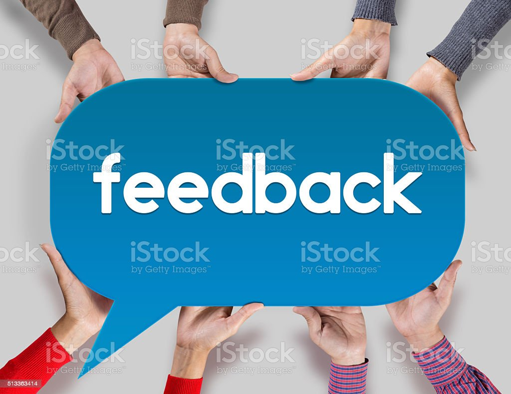 Group of friends showing feedback on speech bubble stock photo