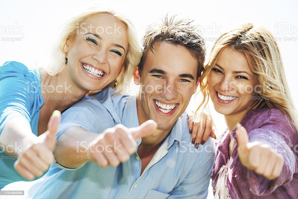Group of friends showing thumbs up. royalty-free stock photo
