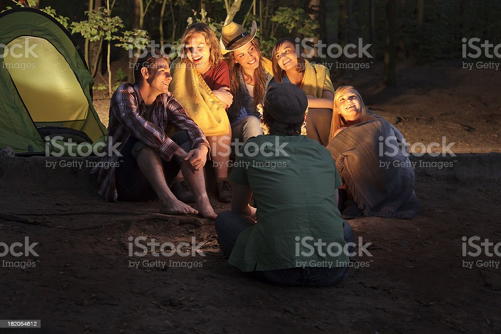 Group of Friends Sitting Around a  Campfire royalty-free stock photo