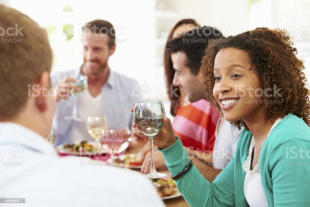 Group Of Friends Sitting Around Table Having Dinner Party royalty-free stock photo