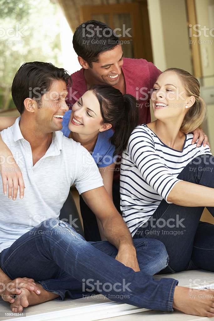 Group Of Friends Sitting Outside House royalty-free stock photo