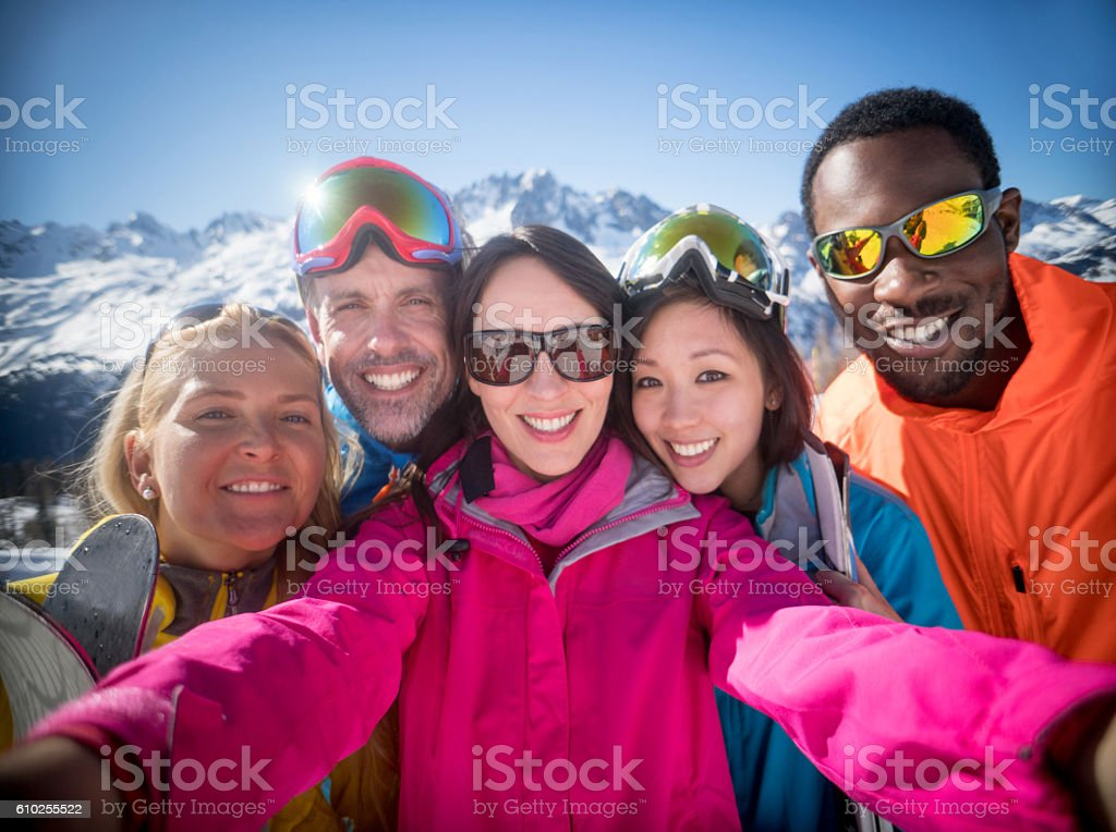Group of friends skiing and taking a selfie stock photo