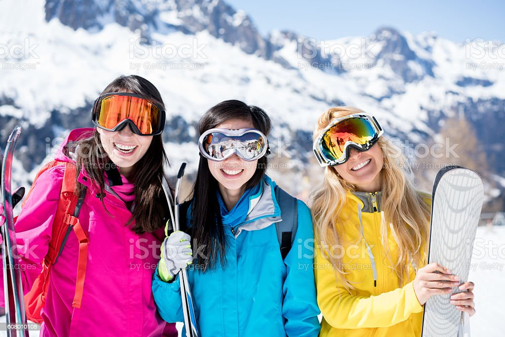 Group of friends skiing stock photo