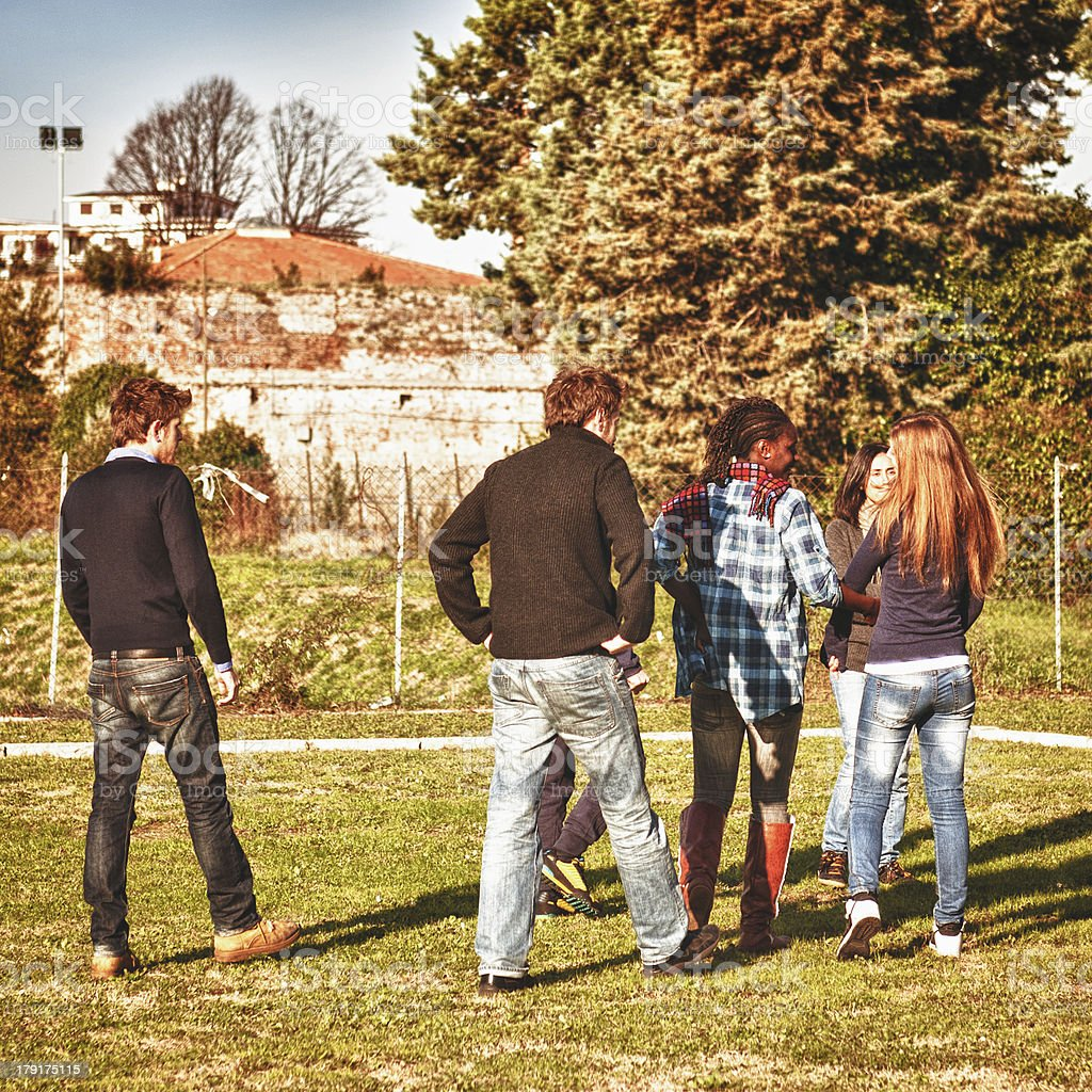 Group of friends standing outdoors royalty-free stock photo