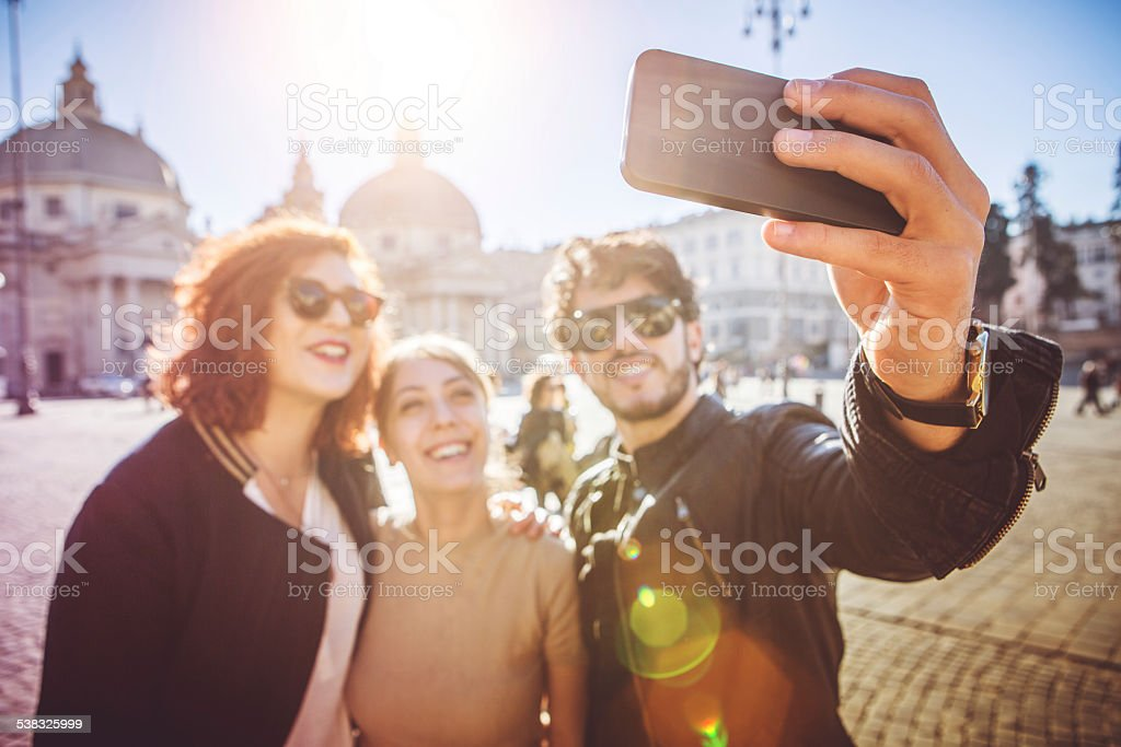 Group of friends taking a selfie in Rome stock photo