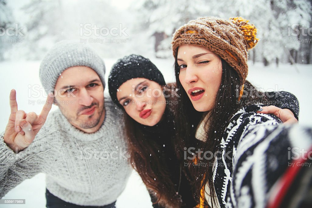 group of friends taking a selfie stock photo