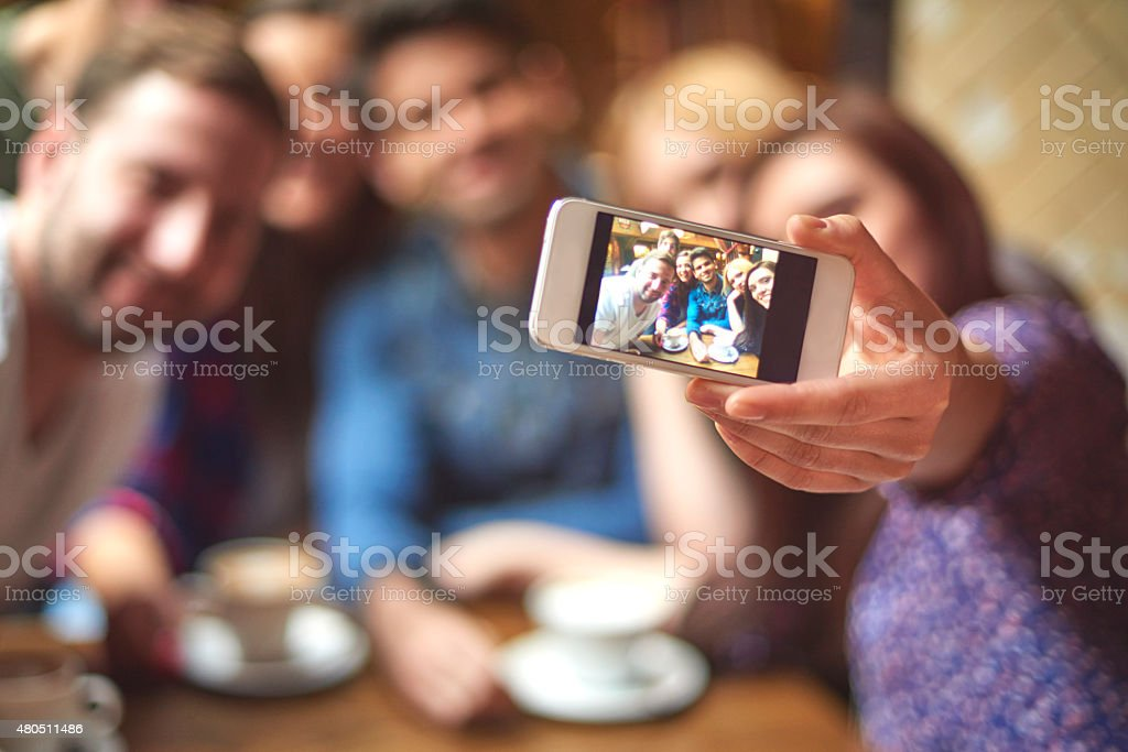 Group of friends taking selfie in the cafe stock photo