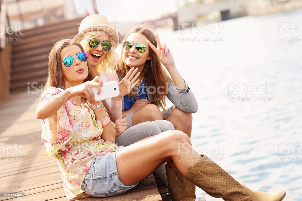 Group of friends taking selfie in the city stock photo