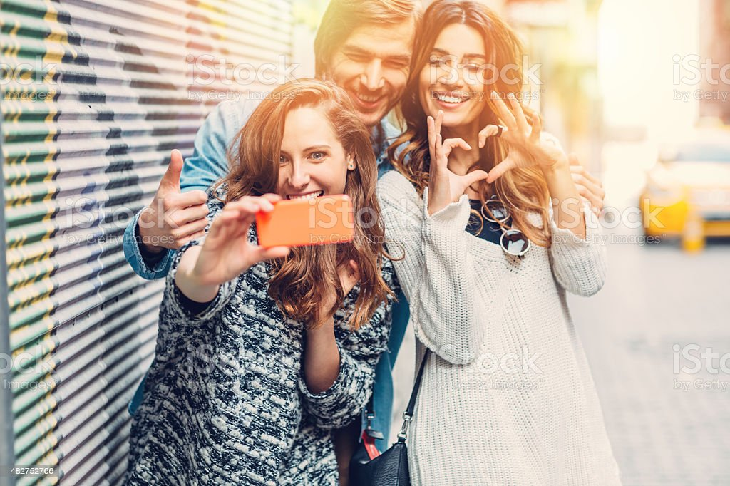Group of friends taking selfie together stock photo