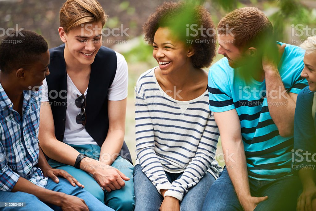 Group of friends talking stock photo