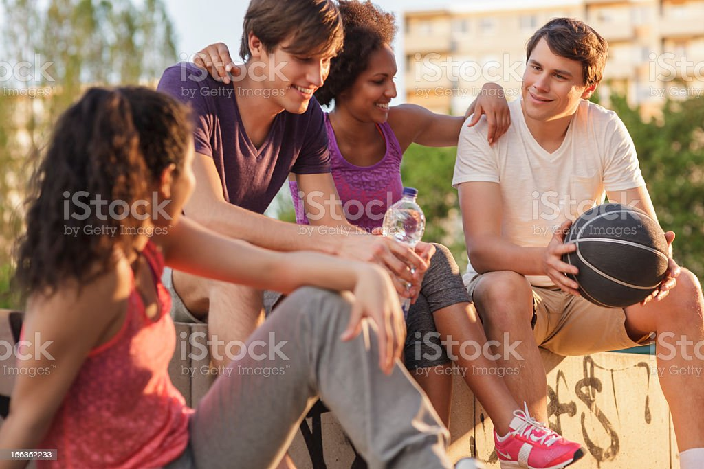 Group of Friends Talkng After Basketball Game stock photo