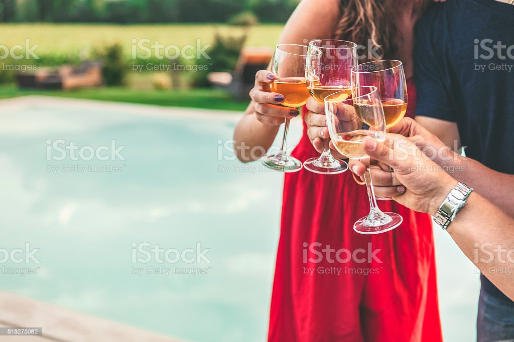 Group of friends toast wine in cheerful moment stock photo